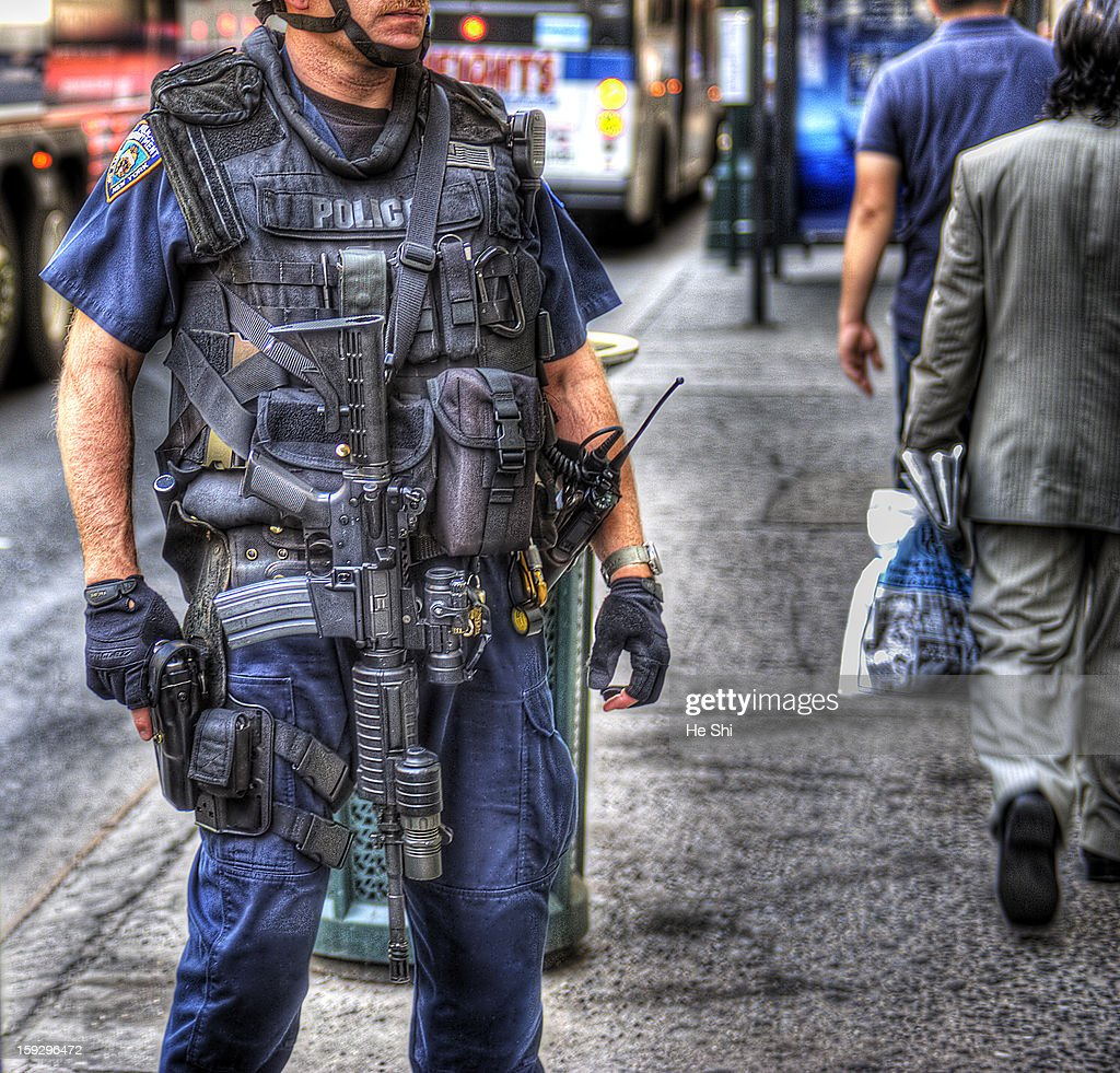 CONTENT] Member of the New York City Police Department (NYPD) Emergency Service Unit (ESU) conducting high visibility terrorism deterrent operations near the subway entrance in Midtown Manhattan.Heavily armed with carbine rifles and ballistic vests. The Hercules Operations has been around ever since 9/11, the Police Department hope to use the 'big guns' to deliver shock and awe.