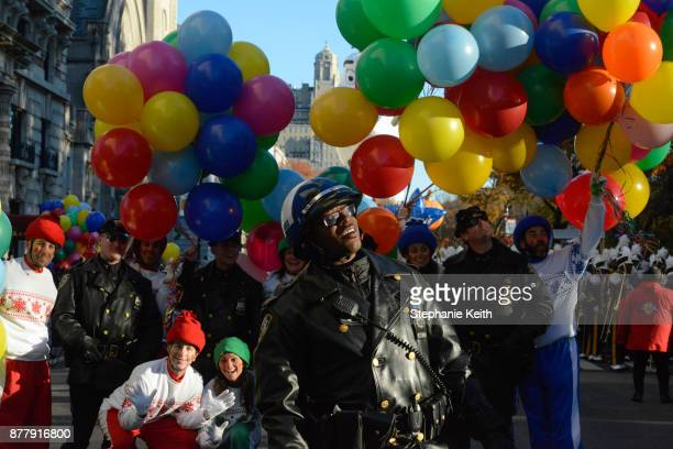 A member of the New York City police department is seen on Central Park West during the annual Macy's Thanksgiving Day parade on November 23 2017 in...