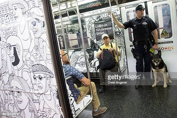 A member of the New York City Police Department K9 Unit patrols on a subway train between Grand Central Terminal and Times Square September 18 2016...
