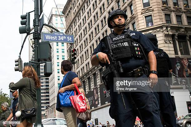 A member of the New York City Police Department stands guard in Herald Square September 18 2016 in New York City Following Saturday night's explosion...