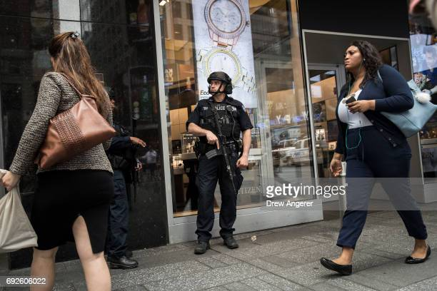 A member of the New York City Police Department's counterterrorism squad patrol in Times Square June 5 2017 in New York City Following another...