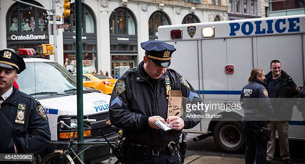 A member of the New York Police Department holds a suspicious package that was found in a subway station and had to be investigated by the Bomb Squad...