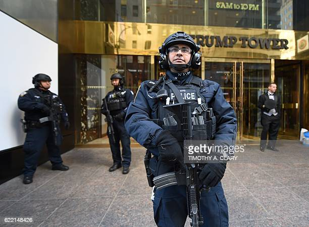A member of the New York Police Department stands in front of Trump Tower on 5th Avenue to provide security to US Presidentelect Donald Trump on...
