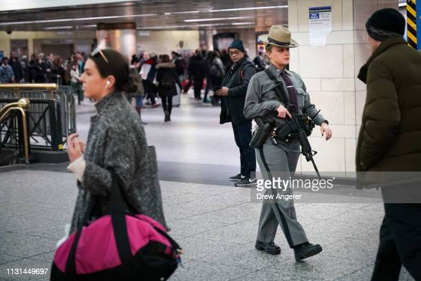 A member of the New York State Police patrols inside Penn Station March 18 2019 in New York City After a gunman killed three people on a tram in The...