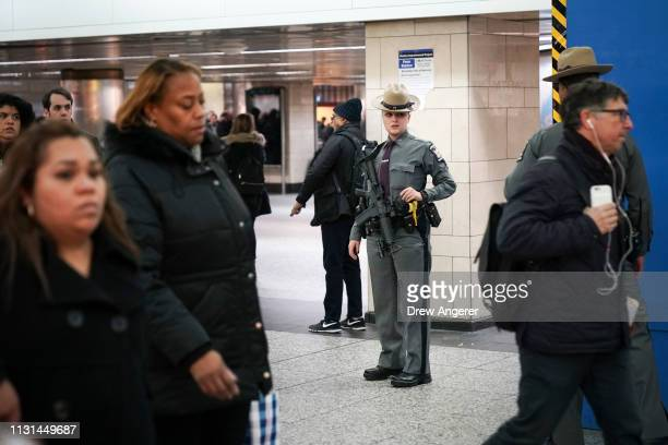 A member of the New York State Police stands watch inside Penn Station March 18 2019 in New York City After a gunman killed three people on a tram in...