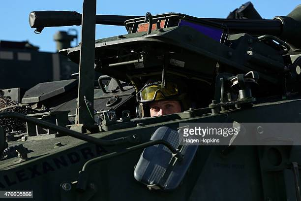 Member of the New Zealand Defense Force looks on from a Light Armoured Vehicle prior to being loaded into the HMNZS Canterbury at Aoeta Wharf on June...