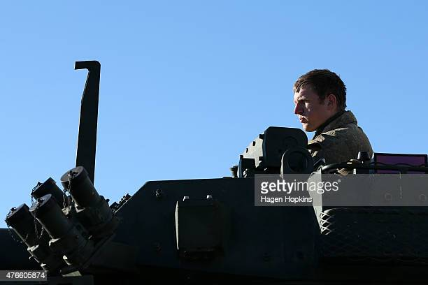 A member of the New Zealand Defense Force looks on from a Light Armoured Vehicle prior to being loaded into the HMNZS Canterbury at Aoeta Wharf on...
