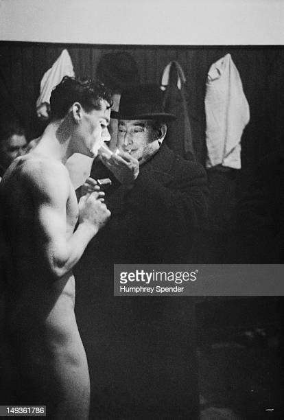 A member of the Newcastle United football team accepts a light from club Director Stan Seymour in the changing rooms north east England March 1939...