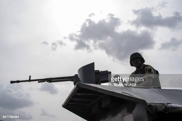 A member of the Nigerian Military Police sits on an armoured vehicle during the African Land Forces Summit military demonstration held at General Ao...