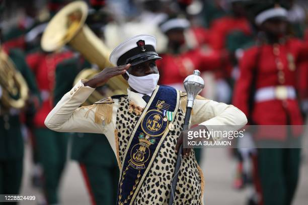 Member of the Nigerian Navy Force band salutes at the Eagles Square in Abuja, Nigeria during the countrys 60th Independence Celebration on October 1,...