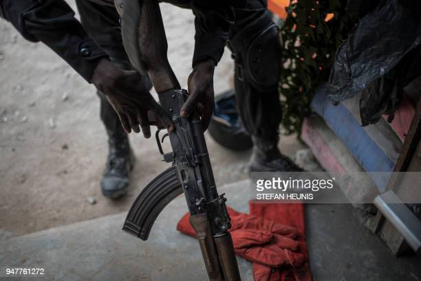 A member of the Nigerian Special Forces Unit reassembles an AK47 assault rifle during the African Land Forces Summit military demonstration held at...