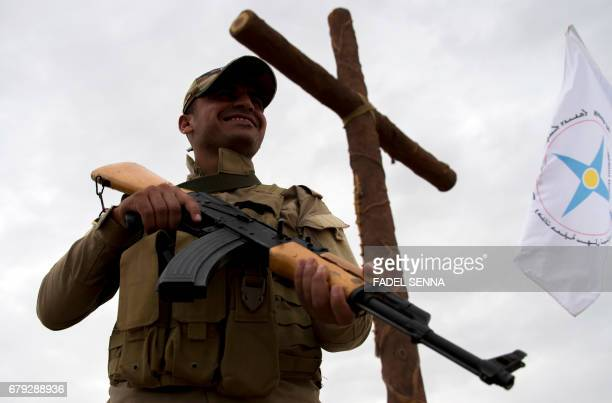 A member of the Nineveh Plain Protection Units a small Christian militia charged with protecting the predominantly Christian Iraqi town of Qaraqosh...