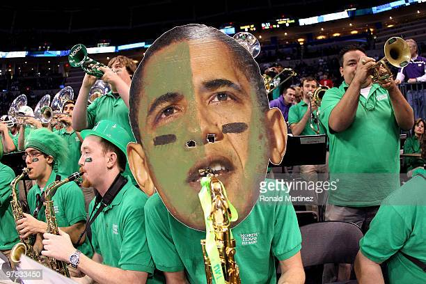 A member of the North Texas Mean Green wears a mask with the likeness of US President Barack Obama as they perform against the Kansas State Wildcats...