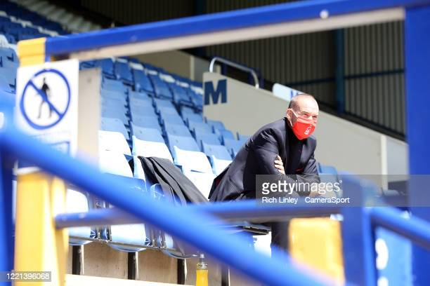 A member of the Nottingham Forest staff wearing PPE looks out from empty stands during the Sky Bet Championship match between Sheffield Wednesday and...
