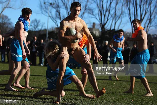 A member of the Nude Blacks runs away to score a try during the nude rugby match between the Nude Blacks and a Fijian Invitational side at Logan Park...
