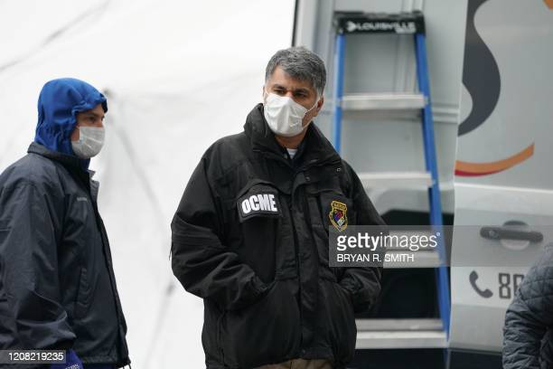 A member of the NYC Medical Examiner's Office at the site as workers build a makeshift morgue outside of Bellevue Hospital to handle an expected...