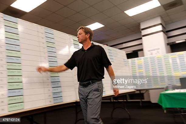 A member of the Oakland Athletics draft team work on the draft board in the Athletics draft room during the first day of the 2015 MLB Draft at Oco...