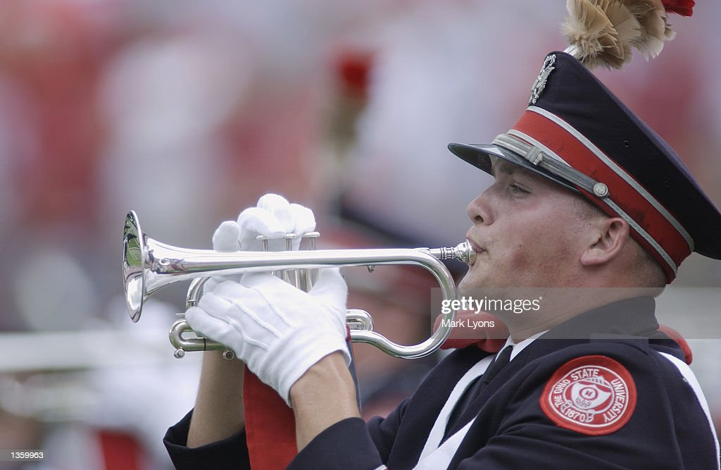 A member of the Ohio State Buckeyes Marching Band plays his flugelhorn before the NCAA Pigskin Classic against the Texas Tech Red Raiders on August 24, 2002 at Ohio Stadium in Columbus, Ohio. Ohio State defeated Texas Tech 45-21.