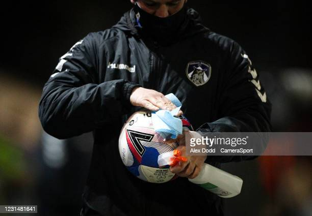 Member of the Oldham Athletic team cleans a ball during the Sky Bet League Two match between Oldham Athletic and Bolton Wanderers at Boundary Park on...