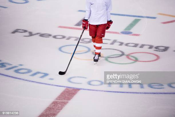 A member of the Olympic Athlete from Russia's women's ice hockey team takes part in a practice session at the Kwandong Hockey Centre in Gangneung on...