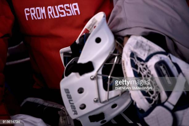A member of the Olympic Athletes from Russia's women's ice hockey team arrives for a practice session at the Kwandong Hockey Centre in Gangneung on...