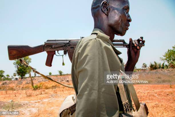 TOPSHOT A member of the opposition troops walks near his base in Thonyor in Leer county on April 11 2017 At least 16 civilians were killed in...