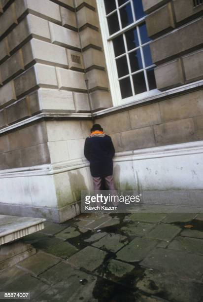 Member of the Orange Lodge relieves himself in a corner during an Apprentice Boys march in Derry , Northern Ireland, 12th August 1986. Known as the...