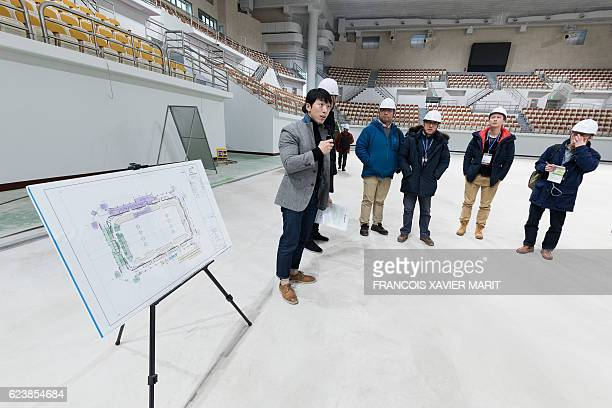 A member of the organisation speaks during a visit by the press of the Gangneung Curling Center on November 9 2016 at the Gangneung Olympic Park...