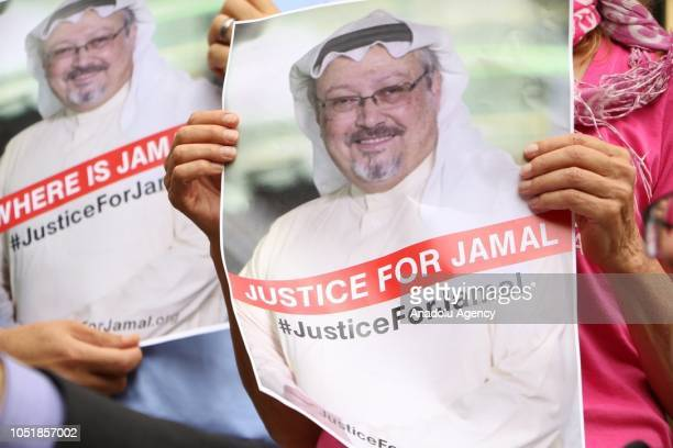 A member of the Organization 'Justice for Jamal Khashoggi' holds a picture of Khashoggi as she and other members hold news conference for...