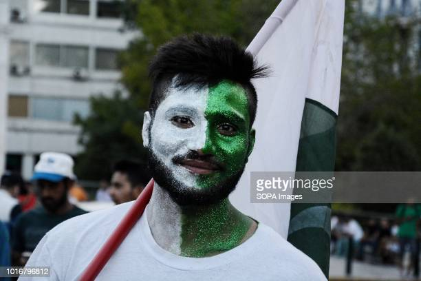 A member of the Pakistan community with a painted face with colors of Pakistani flag is seen at the event Celebration of Pakistan Community of Greece...