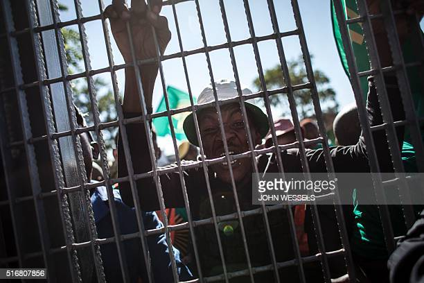 A member of the Pan National Congress protests against South Africa's ruling African National Congress party at the gates of the Human Rights...