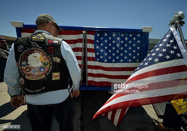 A member of the Patriot Guard Riders group watches the unloading of the 'Fallen Soldiers Cart' which was built by Alaska Airlines staff to ensure the...