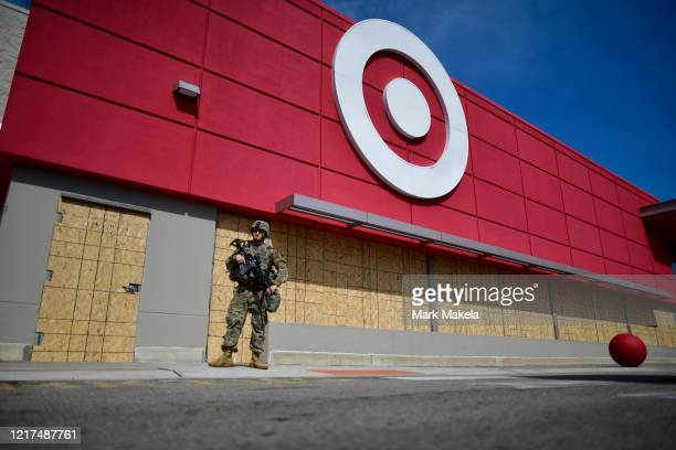 A member of the Pennsylvania National Guard monitors activity outside a shuttered Target store in the aftermath of looting two days ago on June 3...