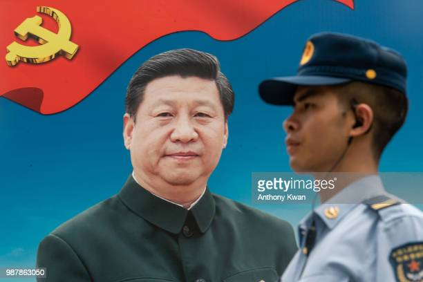 A member of the People's Liberation Army stands guard in front of a billboard of Chinese President Xi Jinping at the Shek Kong Barracks on June 30...
