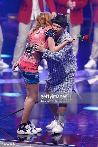 Member of the performer D.M.A Crew touches the bottom of Palina Rojinski during the 1st live show of 'Got to Dance' on August 1, 2014 in Cologne,...