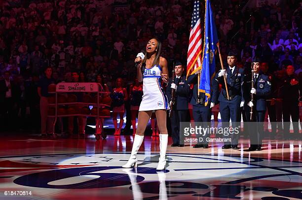 A member of the Philadelphia 76ers dance squad performs the National Anthem prior to the game against Oklahoma City Thunder during game at the Wells...