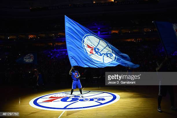 A member of the Philadelphia 76ers dance team holds the team flag logo against the Indiana Pacers at Wells Fargo Center on January 10 2015 in...