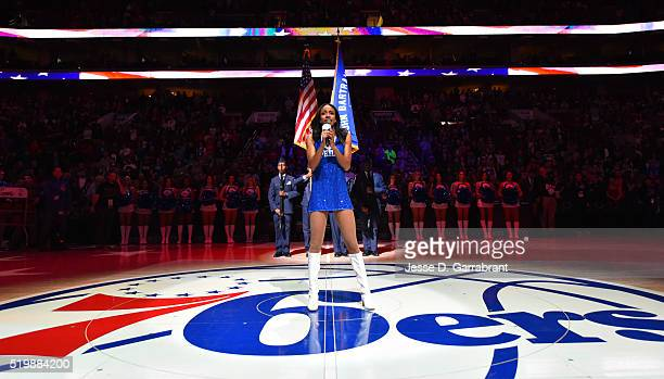 A member of the Philadelphia 76ers dance team sings the national anthem prior to the game against New York Knicks the at Wells Fargo Center on April...