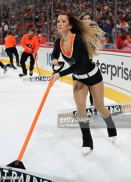 A member of the Philadelphia Flyers ice girls cleans the ice during a timeout against the Nashville Predators on October 19 2017 at the Wells Fargo...