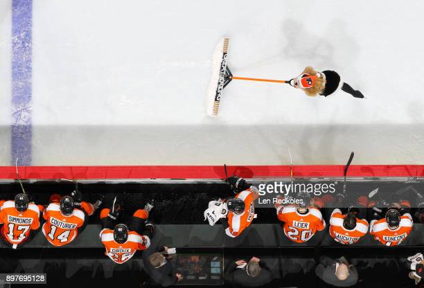A member of the Philadelphia Flyers ice girls cleans the ice during a timeout against the Buffalo Sabres on December 14 2017 at the Wells Fargo...