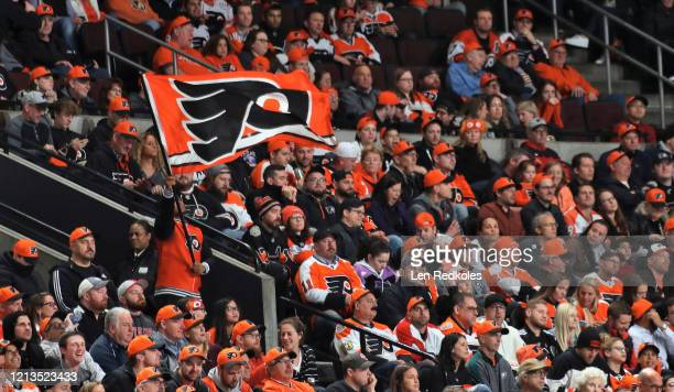 A member of the Philadelphia Flyers ice team waves a flag during an NHL game against the Boston Bruins on March 10 2020 at the Wells Fargo Center in...