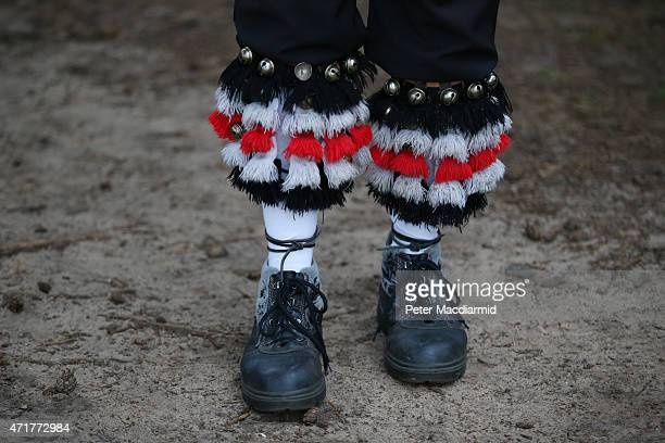 A member of the Pilgrim Morris Men displays his bell pads on St Martha's Hill at dawn before dancing in celebration of May Day on May 1 2015 in...