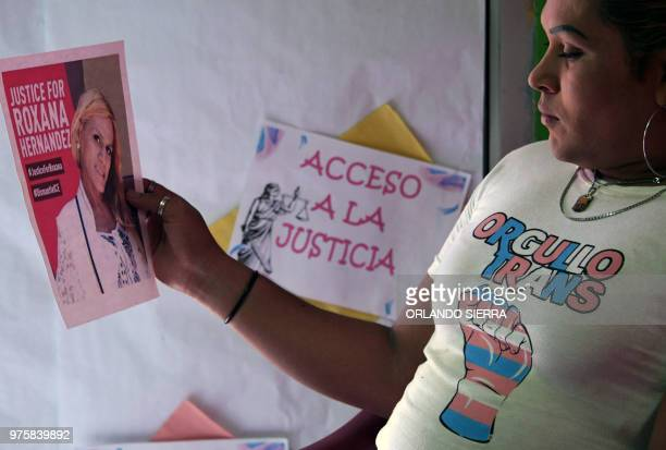 A member of the Pink Unity Collective holds a poster demanding justice in the death of Honduran transgender woman Roxana Hernandez in San Pedro Sula...