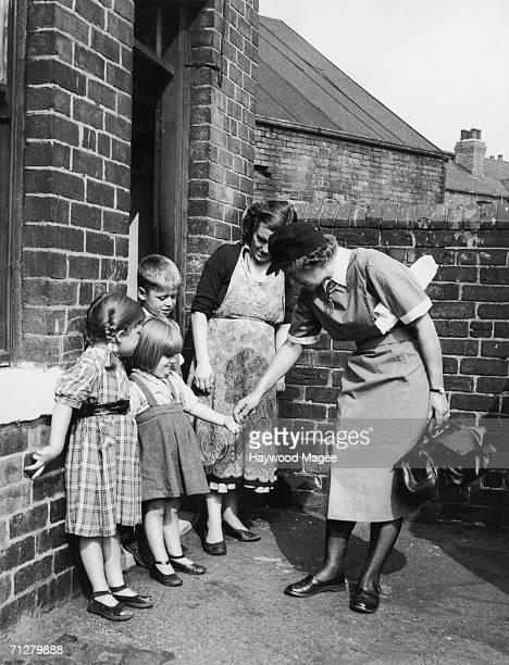 A member of the pioneering home nursing unit makes her rounds in Rotherham south Yorkshire 5th November 1955 Original Publication Picture Post 8132...