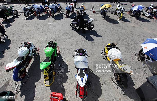 A member of the pit crew wheels out a motorbike during the annual TT races on June 8 2009 Douglas Isle of Man United Kingdom The annual TT race is...