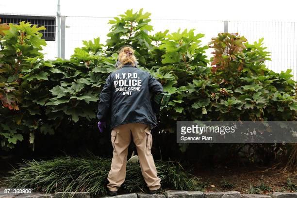 A member of the police department's crime scene unit searches the location where terrorist Sayfullo Saipov drove down a Manhattan bike path and went...