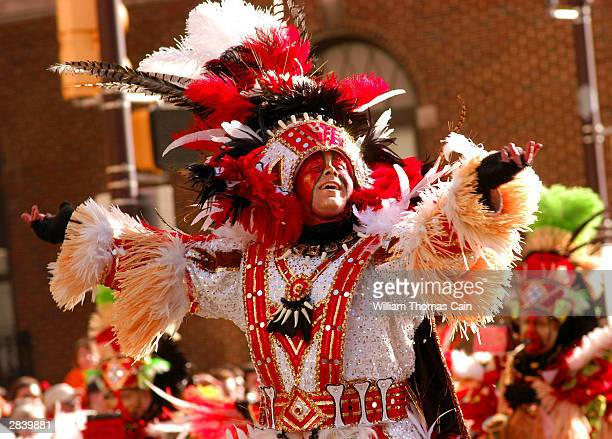 A member of the Polish American String BAnd performs as he marches up Broad Street during the 103rd New Year's Day Mummer's Parade January 1 2004 in...