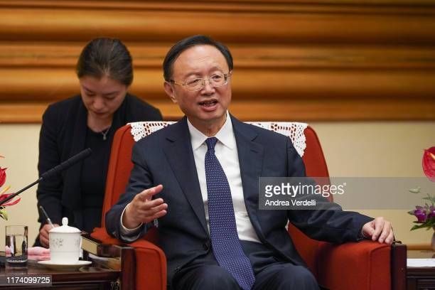 Member of the Politburo of the Communist Party of China Yang Jiechi speaks with Malaysian Foreign Minister Dato' Saifuddin Abdullah during the...