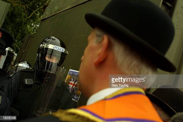 Member of the Portadown Orange Order confronts Royal Ulster Constabulary riot police at an Army barricade at Drumcree Church July 8, 2001 in...