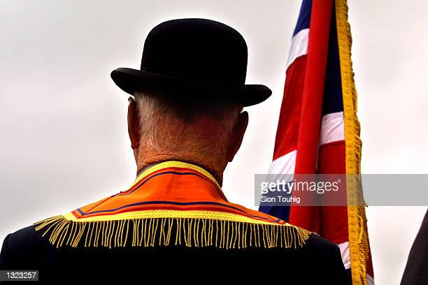 Member of the Portadown Orange Order stands near an Army barricade at Drumcree Church July 8, 2001 in Portadown, Northern Ireland after police...